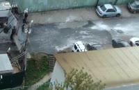 درگیری راننده یک ماشین شاسی بلند با کارکنان گاراژ